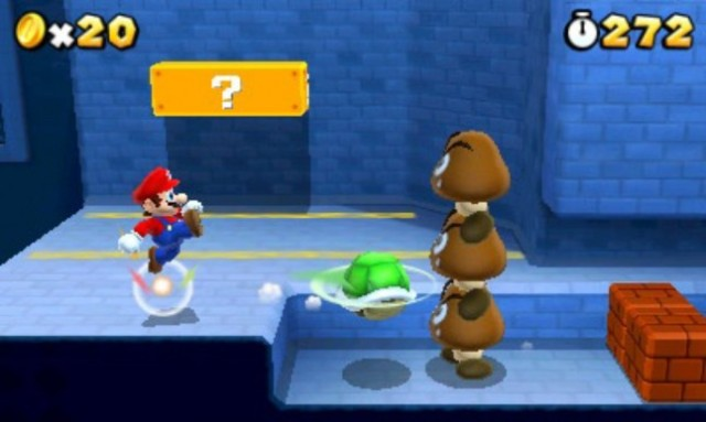 Mario kicking a green shell at some goombas in Super Mario 3D Land